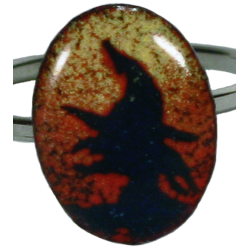 ovale ring with witch head in sky of fire