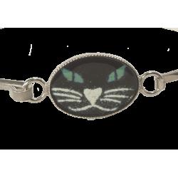 Bracelet ovale tête de chat aux yeux émeraudes