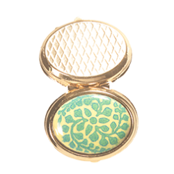golden oval box adorned with an ivy triskel pattern